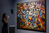 Visitor viewing David Bomberg's 'In The Hold' as part of IK Prize 2015: Tate Sensorium