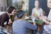 Curator Alison Smith and conservator Natasha Duff discussing Sir John Everett Millais, Bt Hearts Are Trumps 1872 during conservation treatment