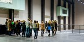 A group of visitors on a guided tour in the Turbine Hall at Tate Modern