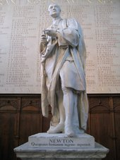 Statue of Isaac Newton at Trinity College, Cambridge showing inscription in Latin 'Newton, who surpassed the human race in understanding'