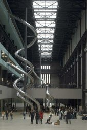 View of Test Site installed in the Turbine Hall at Tate Modern, showing the five spriralling tubular slides that ran from the upper floors of the Gallery to ground level