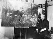 Rousseau in front of his painting Forest Landscape with Setting Sun