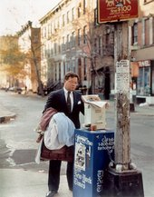 Joel Sternfeld A Lawyer with Laundry, Corner Bank and West 41st Street, NYC 1988