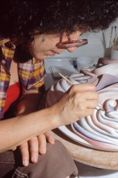 Judy Chicago working on the Georgia O'Keeffe plate for The Dinner Party, c.1976