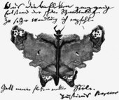 Justinus Kerner A signature illustrated with a Klecksographie 1879 image of a moth made from an ink blot with text at the top and bottom of the picture