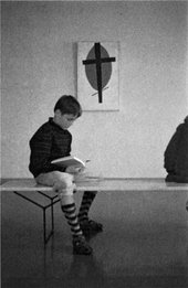 Wolfgang Laib, aged eight, at Ulm Museum sitting in front of Malevich's Mystic Suprematism (black cross on red oval) 1920-2