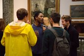 A group of young people chatting in the gallery