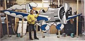 Roy Lichtenstein in his studio with Airplane 1978, created for the set of Kenneth Koch's play The Red Robins, published in L'Espresso, 30 May 1982