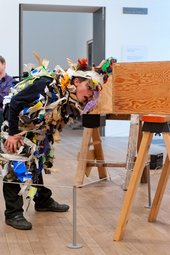 Artist-led schools workshop at Tate Modern, boy looking into box