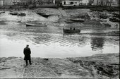 Richard Long standing left in boat crossing the River Avon on the Pill Ferry in march 1969