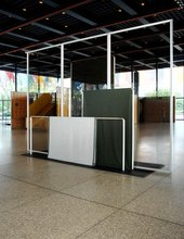 Goshka Macuga Haus der Frau 1 2007 rectangular steel structures with fabrics draped over them with