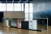 Goshka Macuga Haus der Frau 2 2007 rectangular steel structures with fabrics draped over them with