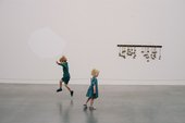 Still from Watch My Steps video featuring two children skipping in the gallery
