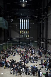 lots of small groups of dancers perform throughout the turbine hall