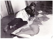 Photo of Maria Lassnig painting in her studio, Vienna 1982