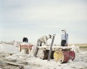 Chloe Dewe Mathews From the series Caspian, 2010 showing 3 men at work building the foundation of a building
