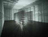 Mesh locker installation with a light placed in the middle to create mesh shadows on the gallery walls