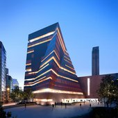 An architectural concept view of the new Tate Modern building at dusk