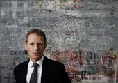 Nicholas Serota, Director of Tate and co-curator of Gerhard Richter: Panorama at Tate Modern, standing in front of Richter's Cage 4 2006