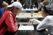 Two young people playing chess at Tate Modern