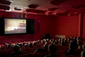 Local residents watching a film screening