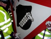 Police raid on Brian Haw's placards. Photo: Rikki Blue
