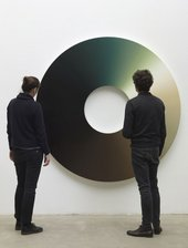 Installation view of Olafur Eliasson's Colour experiment no. 60, two people looking at the artwork