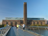 People on the Millennium Bridge walking toward Tate Modern