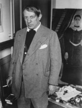 Brassaï, photo of Picasso in his studio at 23 rue La Boétie, standing in front of Rousseau's Portrait of a Woman 1932