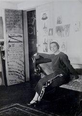 Sonia Delaunay in front of her door-poem in the Delaunay's apartment, Boulevard Malesherbes, Paris 1924