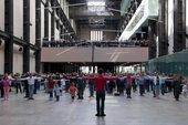 members of the public stood in the vast turbine hall preparing to dance