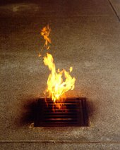 Roger Hiorns Vauxhall 2003 flames arising from a grate in the floor