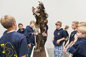 A group of schoolchildren viewing Umberto Boccioni Unique Forms of Continuity in Space 1913, cast 1972