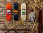 Three skateboards are hung on the wall with the Andy Warhol campbell soup image on each one