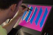 A man using the interactive drawing screens at Tate Modern
