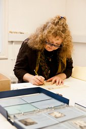 Tate Britain preservation volunteer Tara re-numbering Barbara Hepworth correspondence