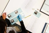 Tate Britain preservation volunteer Nella re-numbering Keith Piper photographs