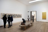 Visitors viewing Jackson Pollock's Summertime: Number 9A at Tate Modern