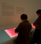 Visitors looking at interpretative material in Room 4 Rothko exhibition, Tate Modern