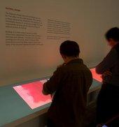 Visitors looking at interpretative material in Room 4 Rothko exhibition, Tate Modern