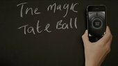 A hand holding an iPhone next to the title The Magic Tate Ball