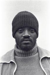 Darcus Howe in hat c. 1970 Copyright 2017 Neil Kenlock