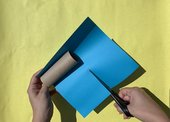 Image of a paper being cut