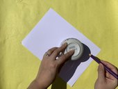 Image of a circle being drawn using a cup
