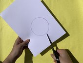Image of a circle being cut out of card