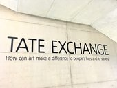 Photograph of text on a wall at Tate Modern reading: TATE EXCHANGE, How can art make a difference to people's lives and to society?