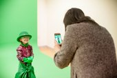 A child playing in front of the green screen in the Clore Learning Centre