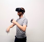 Photograph of a man using a virtual reality headset