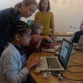 Photograph of kids at a computer