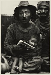 Don McCullin, Strange travellers-a destitute Tibetan family in the booking hall of railway station at dawn, Delhi 1965 © Don McCullin